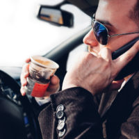 Man talking on phone while driving.jpg.crdownload
