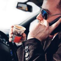 Man talking on phone while driving.jpg.crdownload